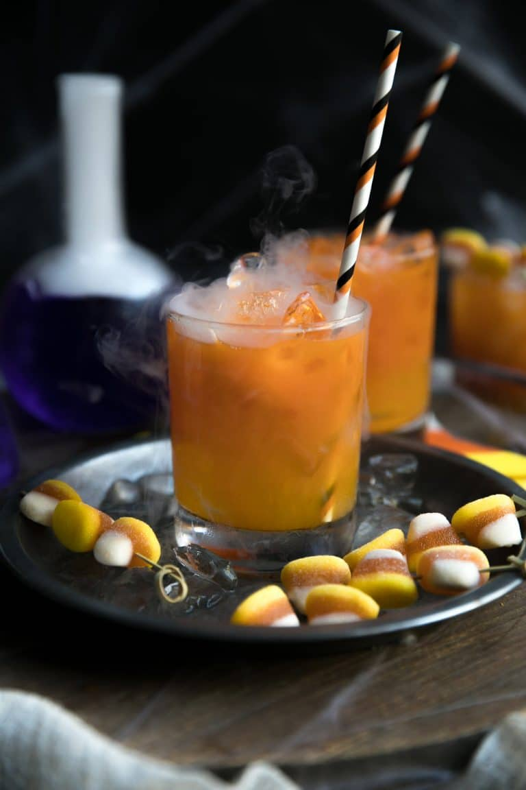 Candy Corn Inspired Carrot and Orange Juice Gin Cocktail with mist