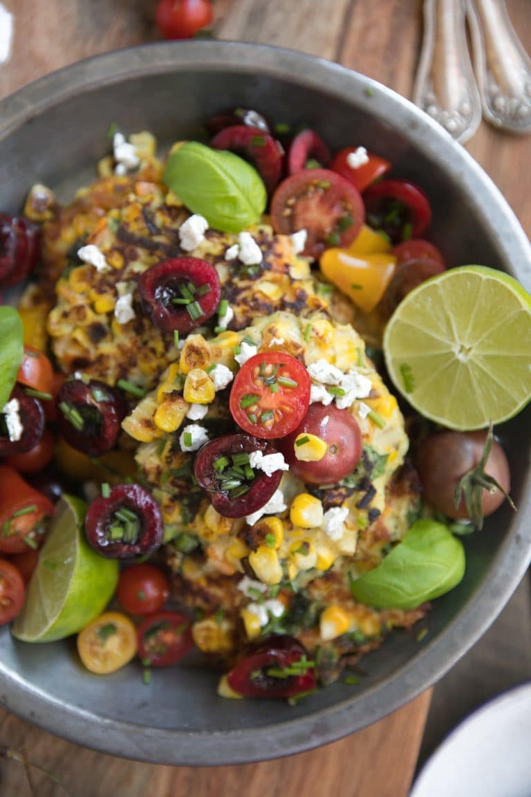 close up image of corn and goat cheese fritters with cherry and tomato salsa