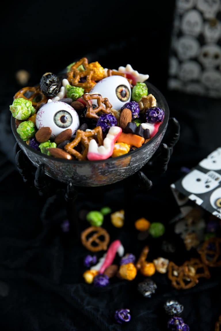 bowl bursting with Halloween Monster Mash Party Mix