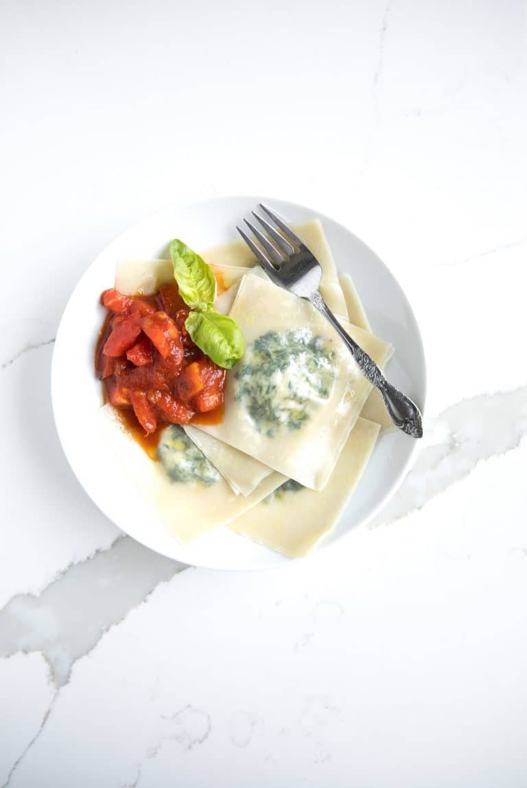 overhead photo of bowl with Mini Spinach and Cheese Ravioli with Homemade Marinara