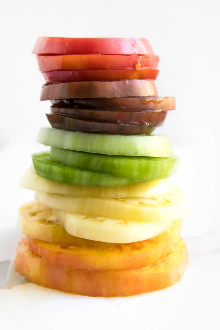 rainbow colored stack of heirloom tomatoes