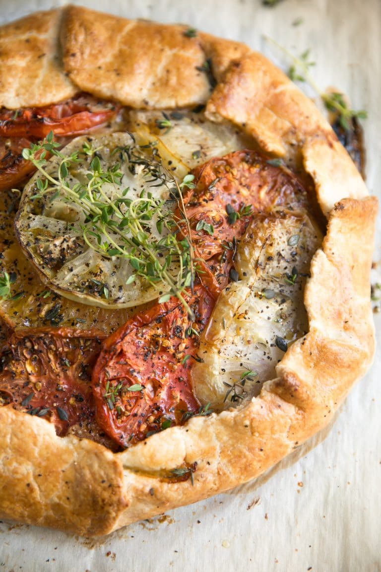 A close up of food, with Tomato Galette and Honey