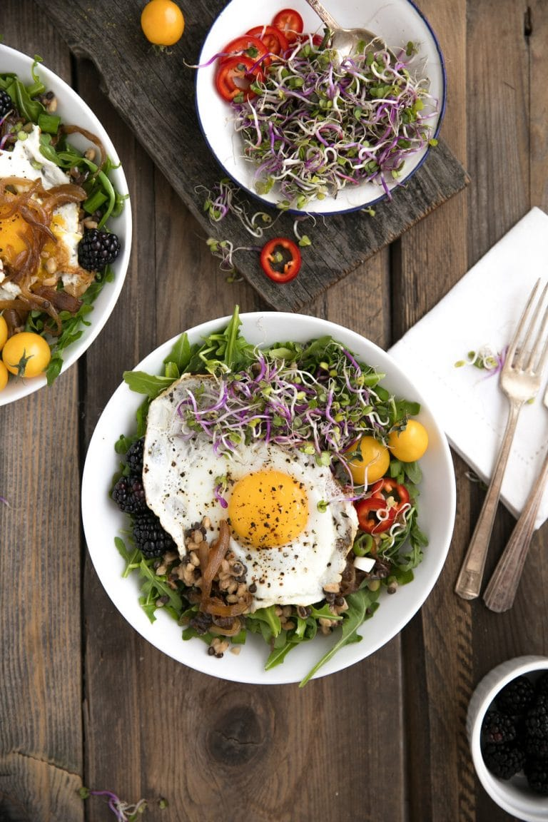 overhead photo of Lentil And Farro Salad With Fried Egg And Jalapeños in bowls