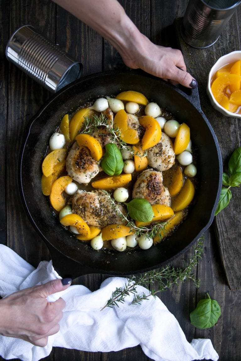 Fresh summer peaches may be on their way out, but that doesn't mean you can't enjoy them all year long in this easy, delicious and super healthy 30 Minute Peach and Chicken Skillet with Pearl Onions.