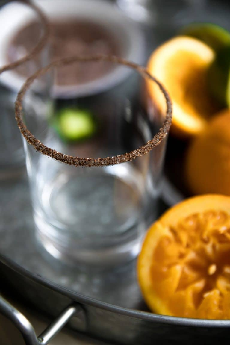 Perfect balance between salty, sweet and spicy, these Spicy Orange Margaritas with Agavero Orange Liqueur are guaranteed to be the life of any (21 years and older) party!