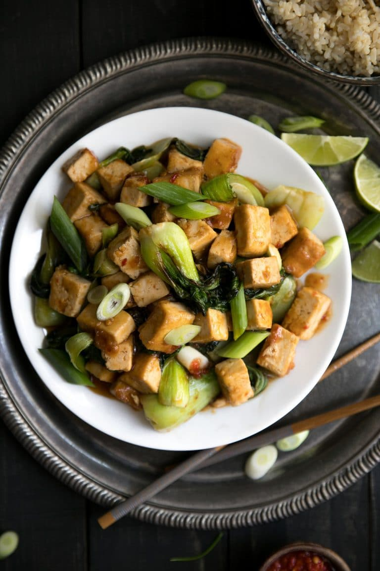 A plate full of food, with Tofu and bok choy