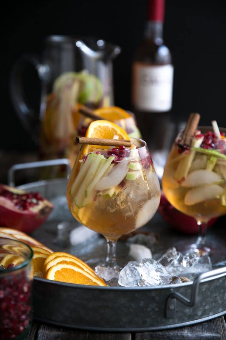side photo of Autumn Rosé Sangria with Apples and Pomegranates in two glasses