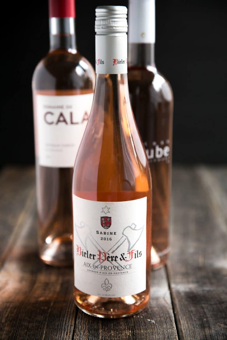 three bottles of different french rose wine