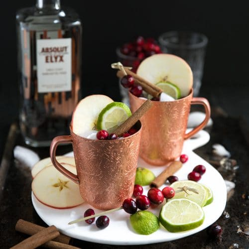 cranberry apple Moscow mules in copper cups