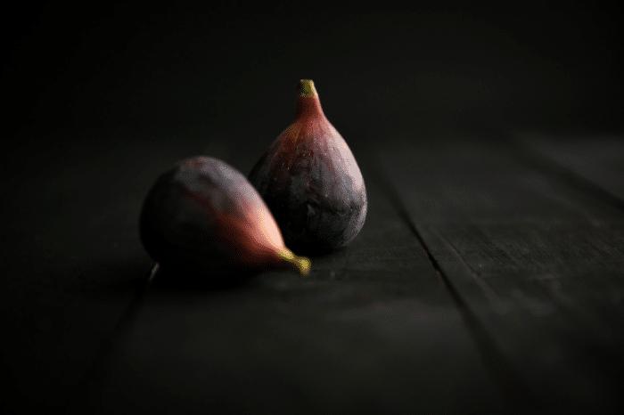 two dark figs dark room