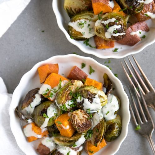 A plate of roasted Brussels sprouts and sweet potatoes