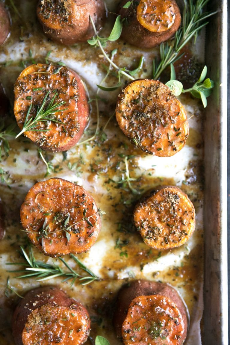 Brown Sugar and Herb Roasted Sweet Potatoes in a baking sheet