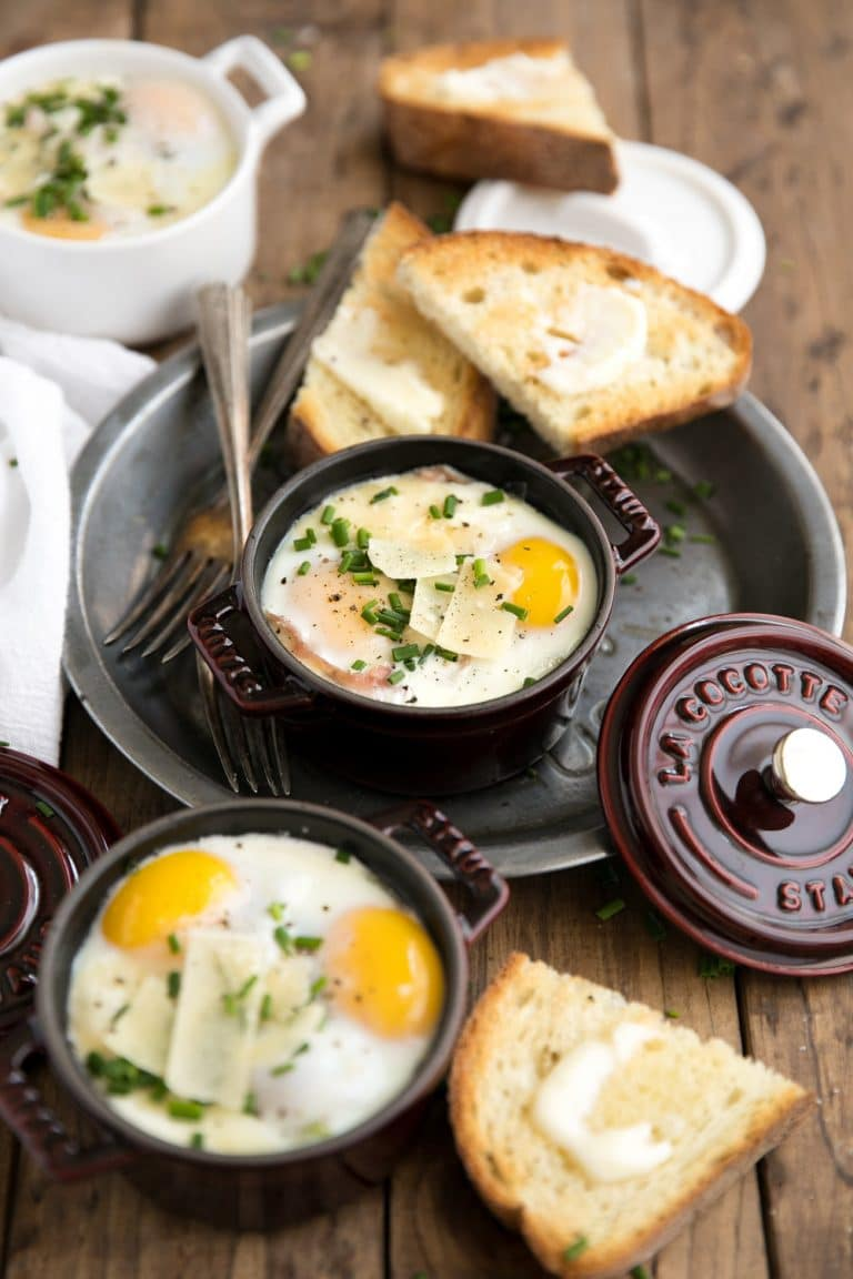 Perfect for entertaining but easy enough to make for just one, these Creamy Baked Eggs in Mini Cocottes with Spinach and prosciutto are delicious, fun-size and the perfect place to dip all the buttered bread.