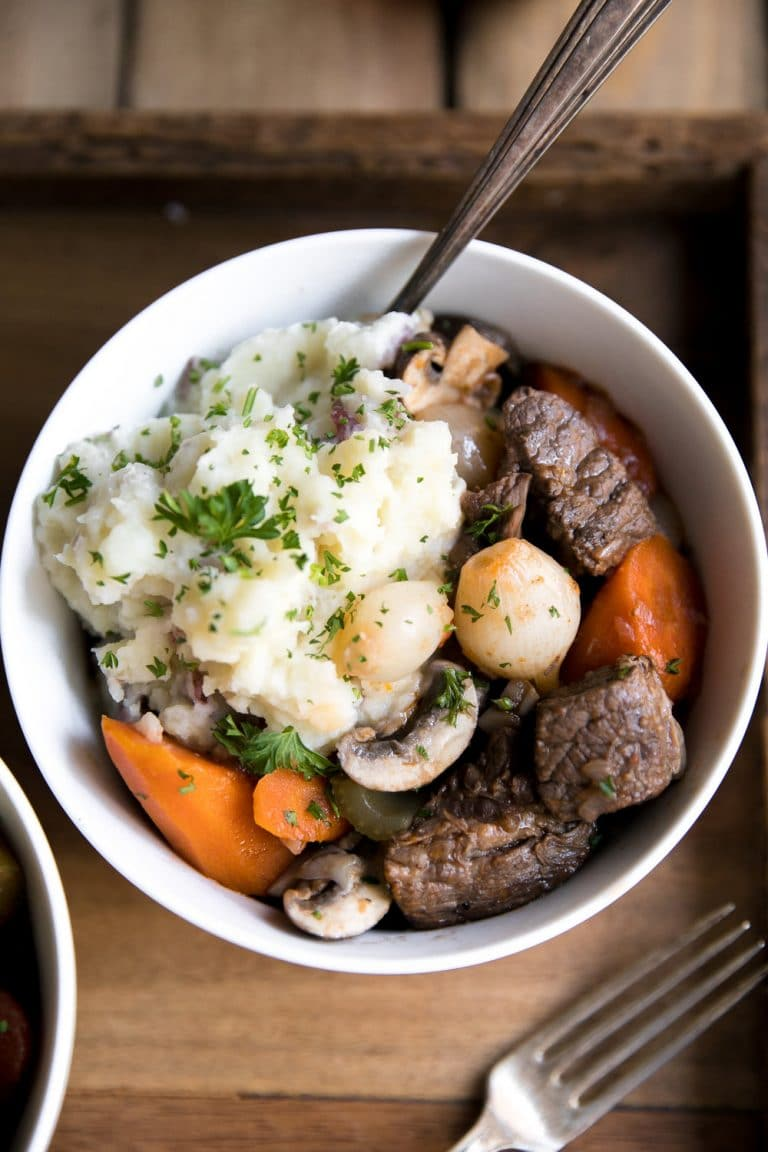 close up of bowl with mashed potatoes and Best Slow Cooker Beef Bourguignon