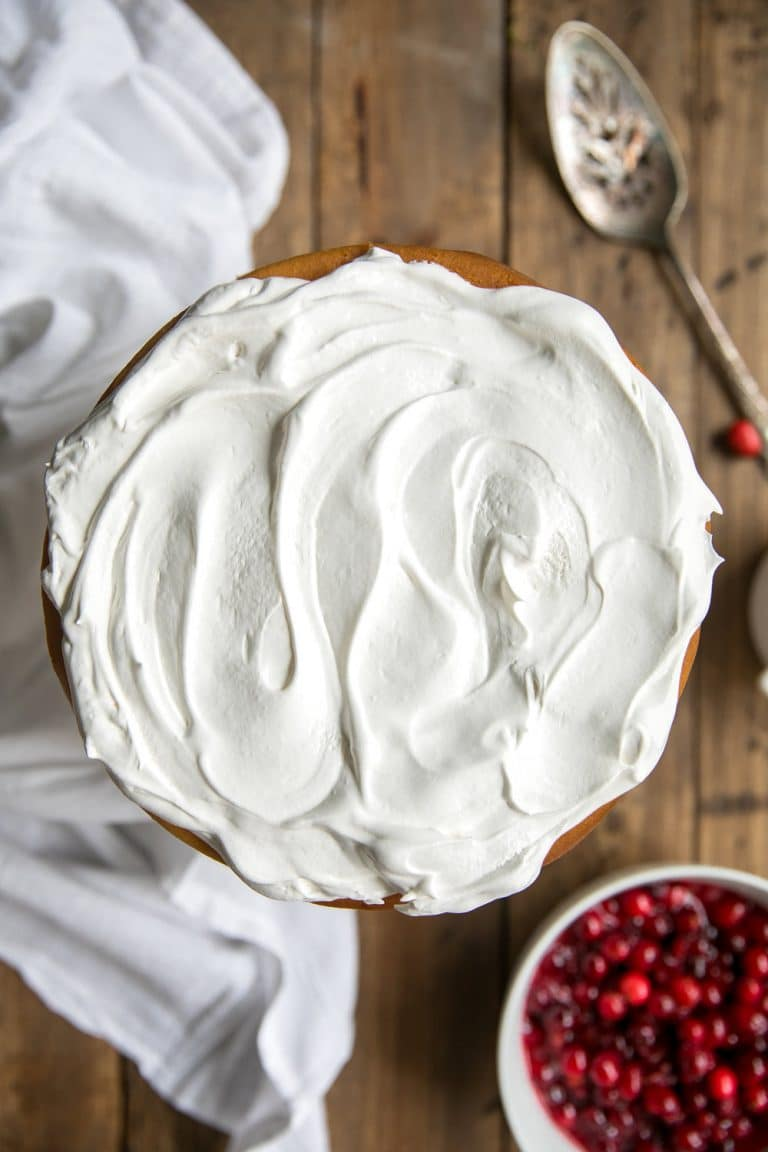 Easy Cranberry White Chocolate Cheesecake with Homemade Cranberry Pomegranate Sauce and Whipped Cream