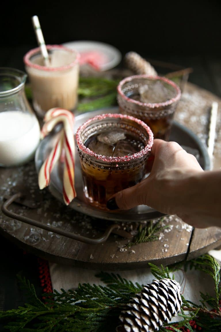 Holiday Peppermint White Russian. Made with Kahlúa, Peppermint Schnapps, and Vodka, this delicious cocktail is perfect for the cold holiday season.
