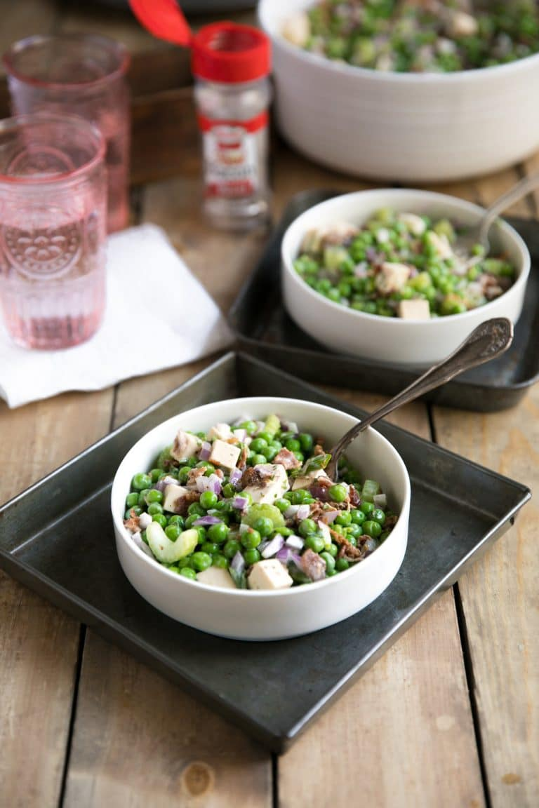 The perfect no-bake, fast, easy, and delicious side dish for any holiday party or summer BBQ, this Easy and Creamy Pea Salad is filled with cubes of smoked gouda, crunchy celery and plenty of bacon!