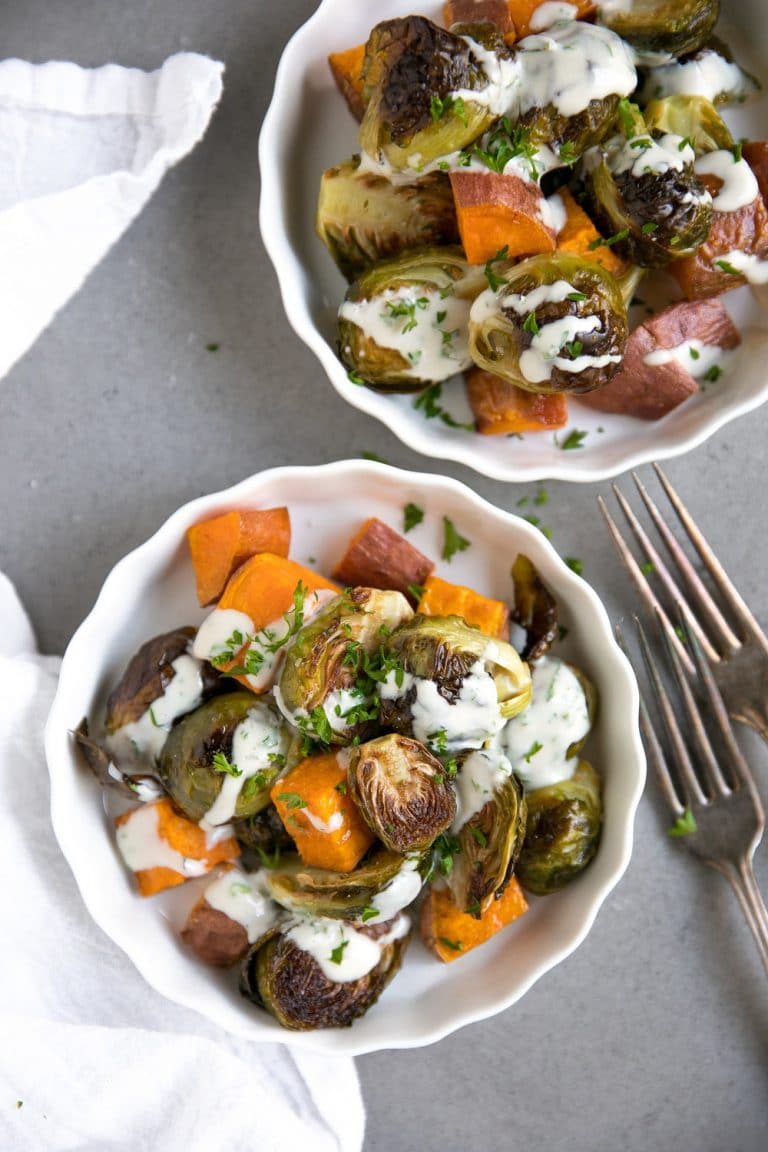 16 Easy and Delicious Thanksgiving Recipes. Easy Roasted Brussels Sprouts and Sweet Potatoes with Tahini Sauce