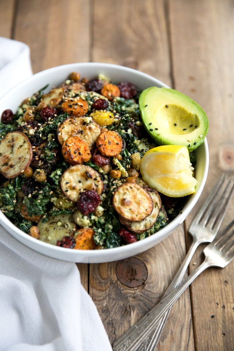 This Kale and Roasted Veggie Salad with Tahini Yogurt Pesto combines healthy, energy-packed power foods like kale, chickpeas, and carrots into one delicious bowl.