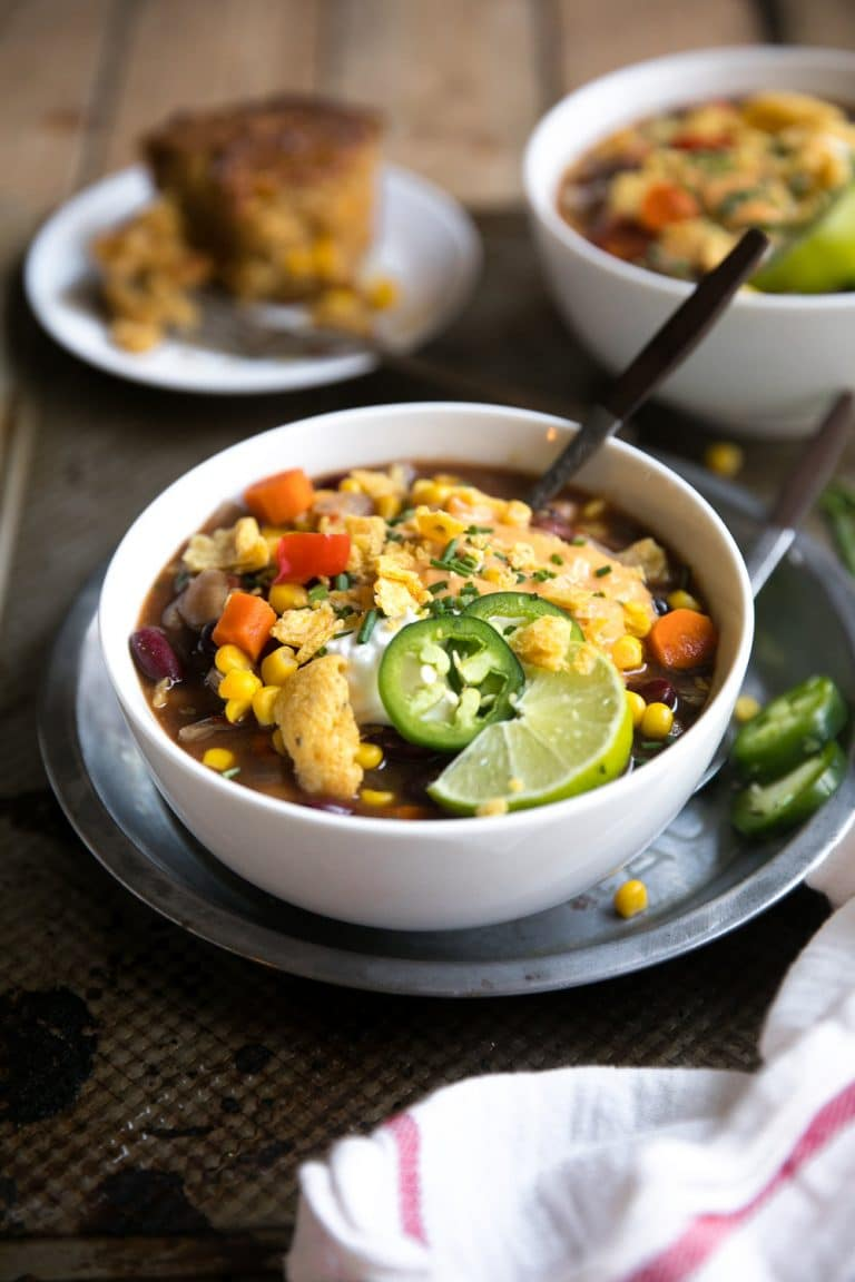 Slow Cooker Vegetarian Chili with Baked Beans. Vegetarian Chili packed full of vegetables, baked beans, corn, and tomato topped with sour cream and cheese.