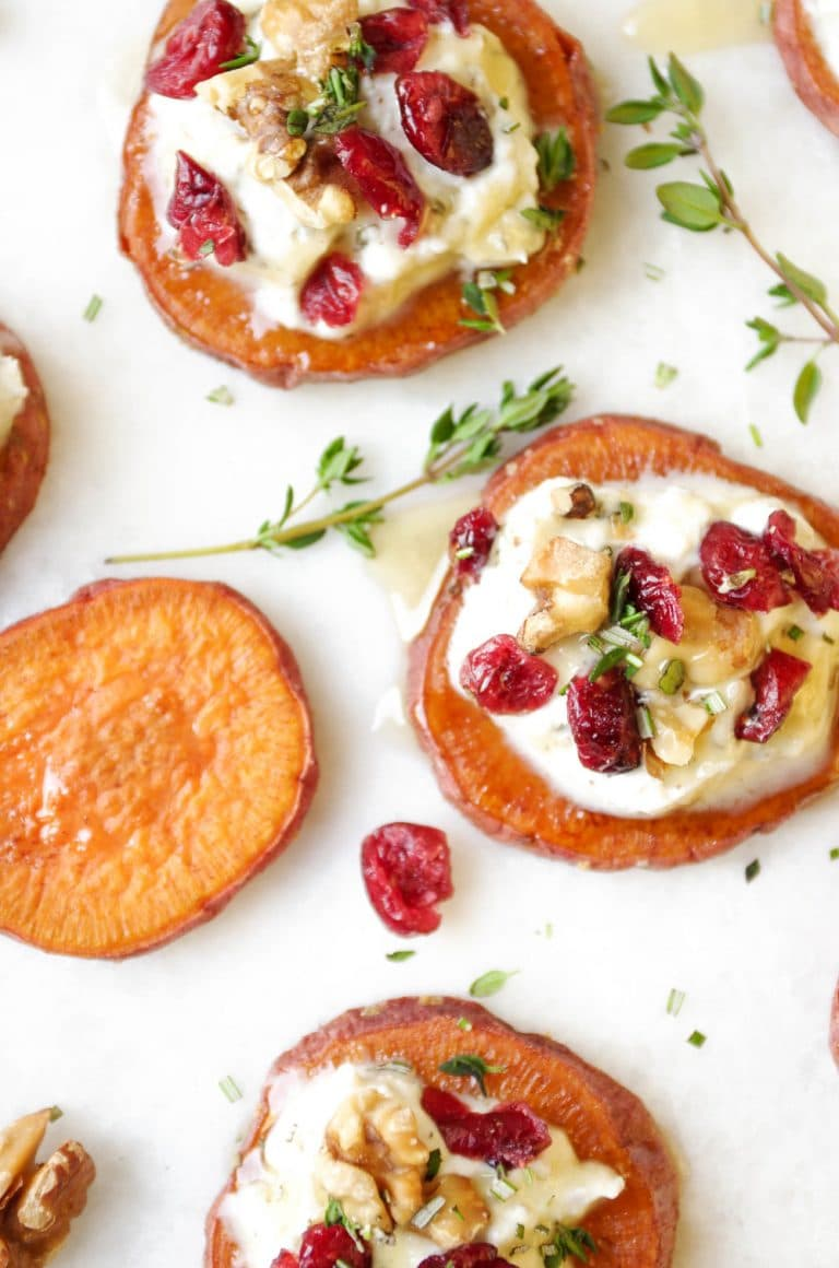 16 Easy and Delicious Thanksgiving Recipes. Sweet Potato Rounds with Ricotta, Walnuts, Cranberries and Fresh Herbs