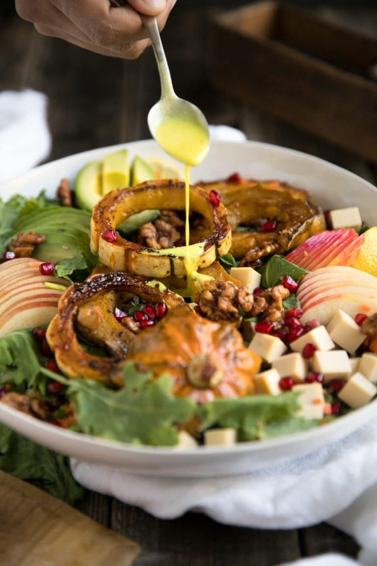 Autumn Turmeric Salad with Apples, roasted Acorn Squash, smoked gouda cheese, walnuts, avocado, pomegranates, and a creamy turmeric vinaigrette