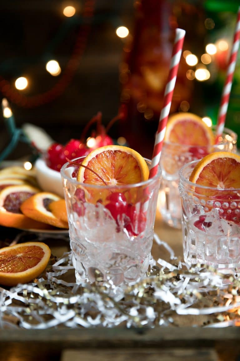 Cinnamon liqueur, bourbon, tart cherry juice, fresh orange wedges and sweet bubbly 7UP mix together to make this Orange and Cherry 7UP Spritzer; a delicious holiday cocktail