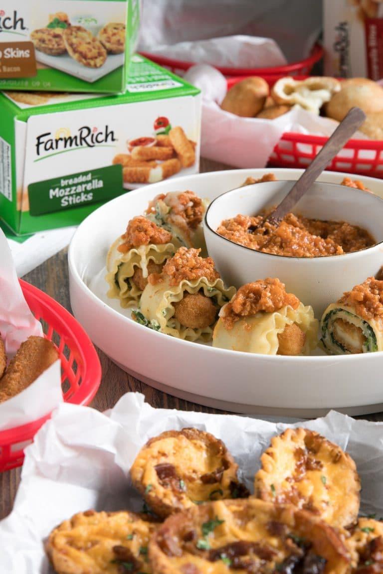 Cheesy Mozzarella Sticks Rolled in Spinach, Ricotta, Marinara, and Noodles to make Bite Sized Mozzarella Stick Lasagna Roll-Ups