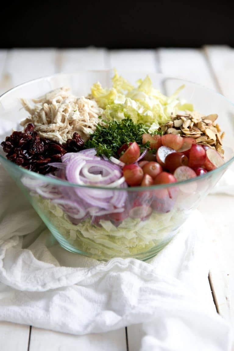 Easy and healthy Chicken and Grape Holiday Slaw is filled with crunchy cabbage, sweet grapes, spicy onion and takes just 10 minutes to throw together.