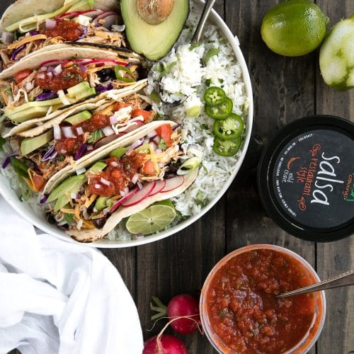 A plate of food on a table, with Instant pot salsa chicken tacos