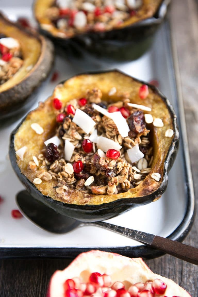 Sweet Cinnamon Baked Oatmeal Stuffed Acorn Squash with Almond Butter, Cranberries, and Pomegranates