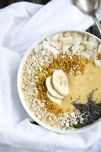 A dessert on a plate, with Banana Mango Smoothie Bowl