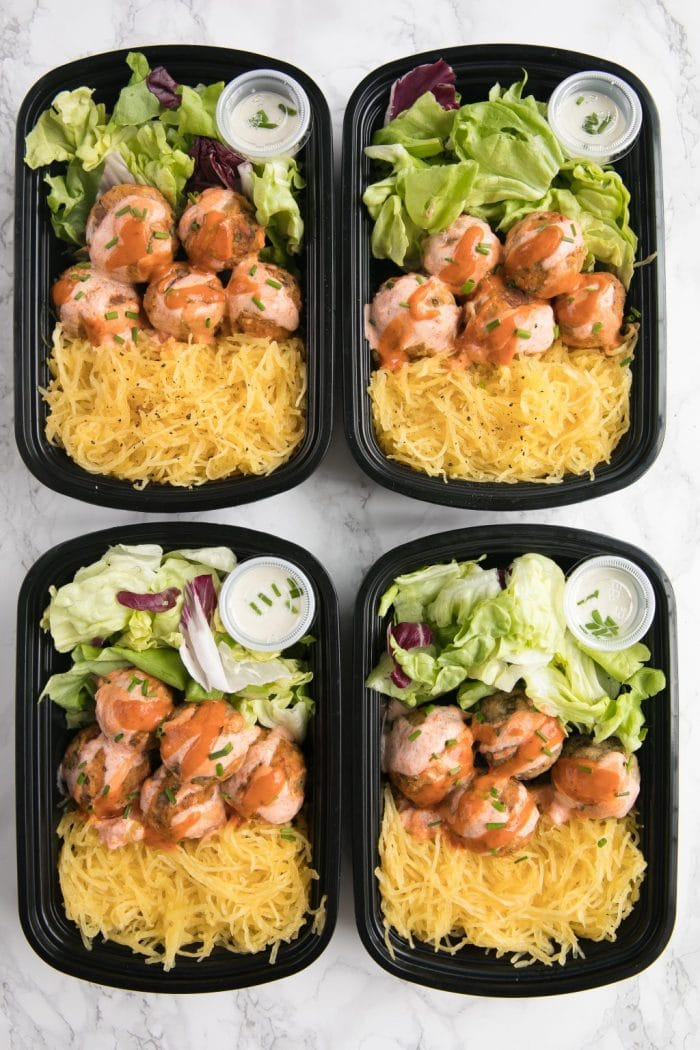 Buffalo Turkey Meatballs in meal prep containers with lettuce, spaghetti squash, and ranch dressing