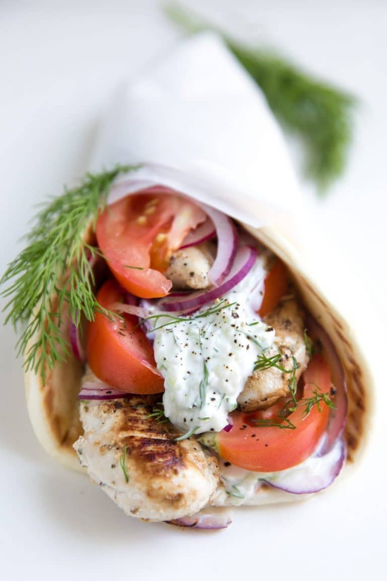 Yogurt Marinated Chicken Gyros with fresh cucumber Tzatziki Sauce wrapped in soft flatbread