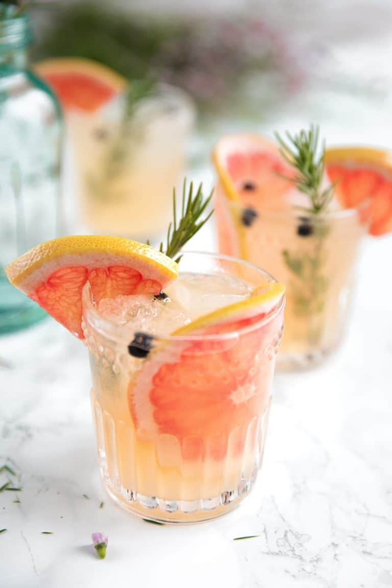 Sweet pink grapefruit juice, fragrant rosemary, and Elderflower Liqueur are added to gin and tonic to make a fresh, refreshing, and fun Elderflower Grapefruit Gin and Ton