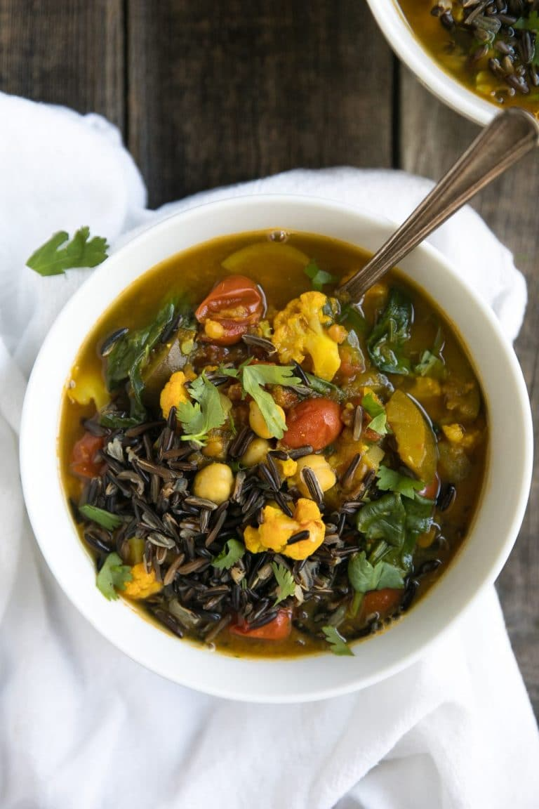 Easy Vegetarian Turmeric Broth Soup with Wild Rice, Chickpeas, Zucchini, Tomatoes, and Cauliflower