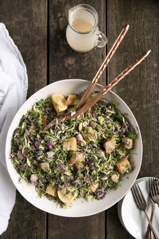 Shredded Brussels Sprouts Caesar Salad with Homemade Croutons