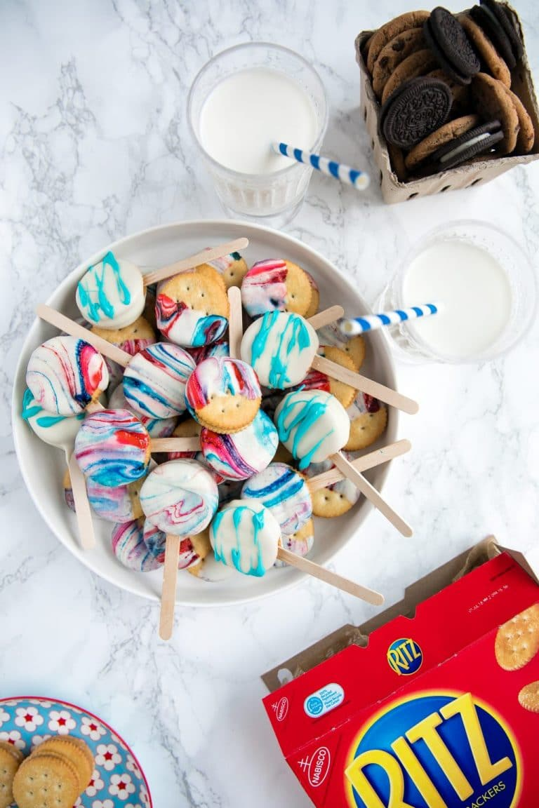 Creamy Peanut Butter Sandwiched between Buttery RITZ Cracker and dipped in swirled Red, White, and Blue melted white Chocolate
