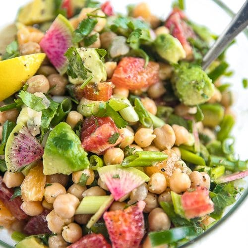 Fresh, healthy, and completely vegetarian, this Avocado Citrus Chickpea Salad is loaded with sweet blood oranges, creamy avocados, spicy green onion, spicy jalapeño, and cilantro. Summertime dinner magic that takes little more than 10 minutes to throw together.