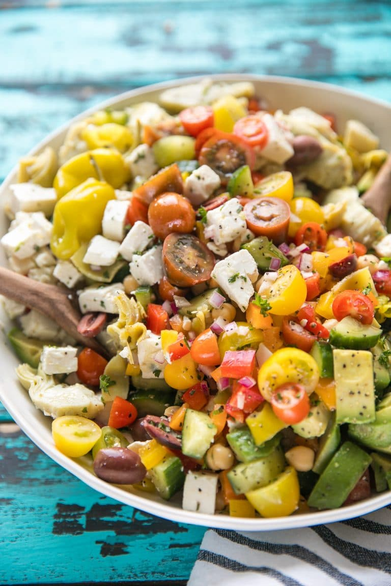 Easy Vegetarian Chopped Mediterranean Salad with chickpeas, avocado, tomatoes, bell pepper, olives, and artichoke hearts.