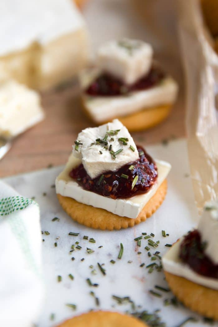 RITZ Cracker, Brie, and Jam bites are the perfect combination of salty, sweet, and savory and take just minutes to prepare.