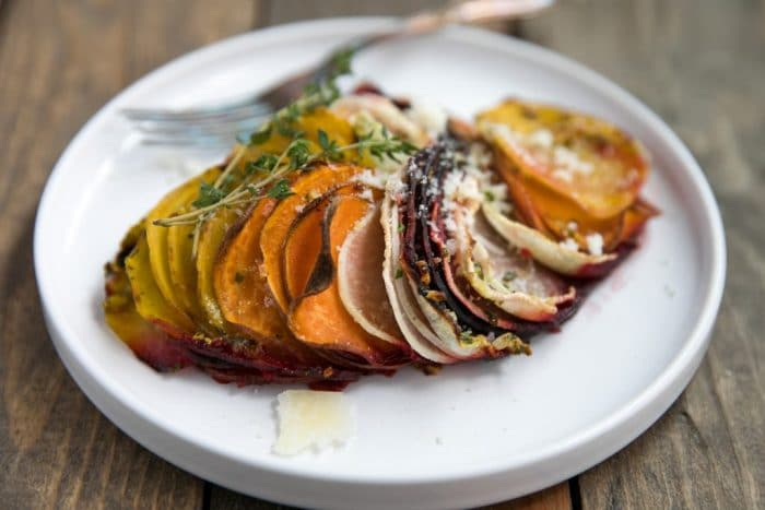 Scalloped Root Vegetable Skillet. Skillet baked with thinly sliced red and yellow beets, sweet potatoes, and parsnips topped with rosemary, butter and parmesan cheese.
