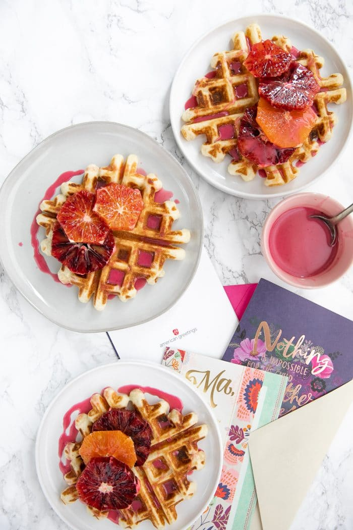 Light, fluffy and perfectly crisp around the edges, these Easy Crispy Waffles with Blood Orange Glaze are delicious for breakfast, brunch, dinner, or even dessert!