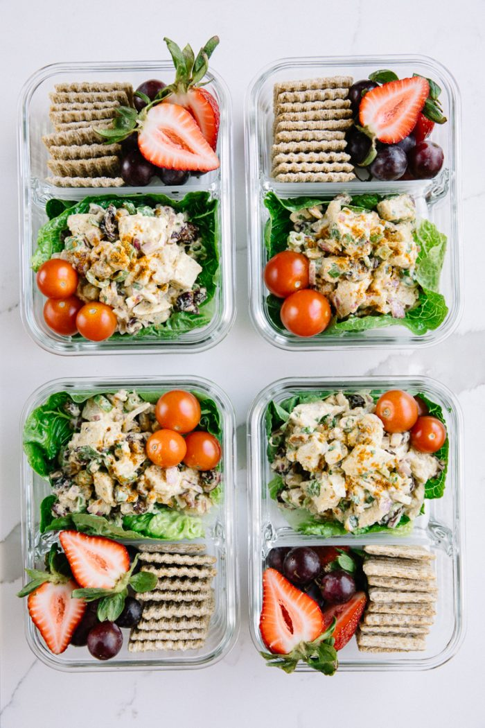 Meal prep snack trays with chicken salad and crackers