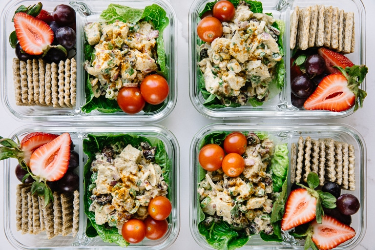 Prepared weekly chicken salad meal prep snack trays with fruit