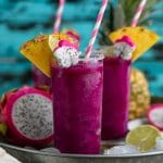 Cold, crisp, and refreshing, these Frozen Pineapple Dragon Fruit Margaritas are the perfect solution for all those hot summer days and backyard BBQs. Swap the tequila for pineapple juice to make a healthy, fruit packed smoothie loved by both kids and adults!