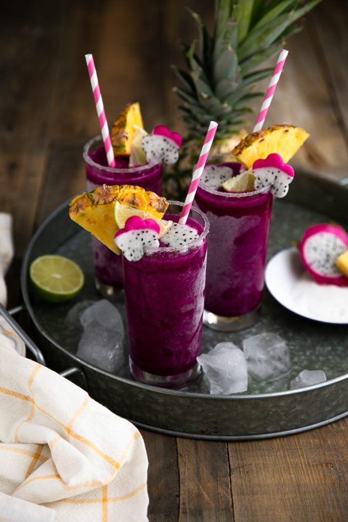 three blended frozen dragon fruit tequila margaritas