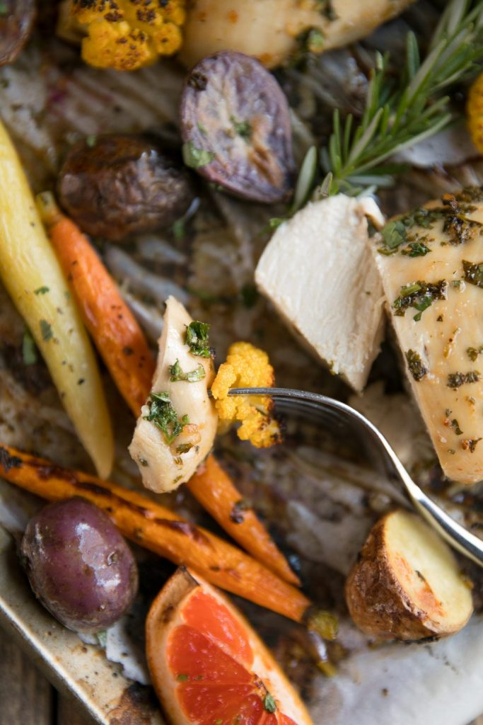 Dinnertime will be a breeze thanks to this healthy and delicious Herb Grapefruit Sheet Pan Chicken with Roasted Vegetables.