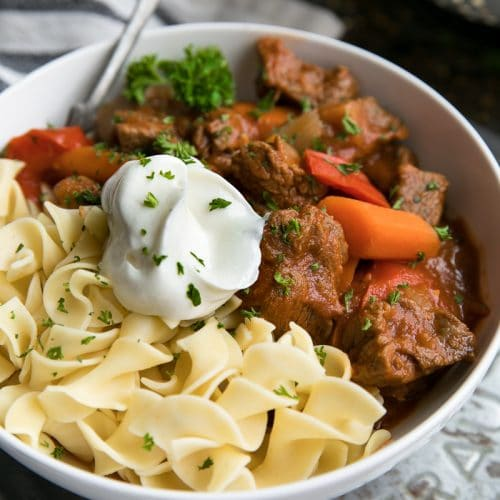 Easy Hungarian Beef Goulash cooked together with tender chunks of beef stew meat, carrots, bell pepper, sweet Hungarian paprika, and a hearty tomato sauce