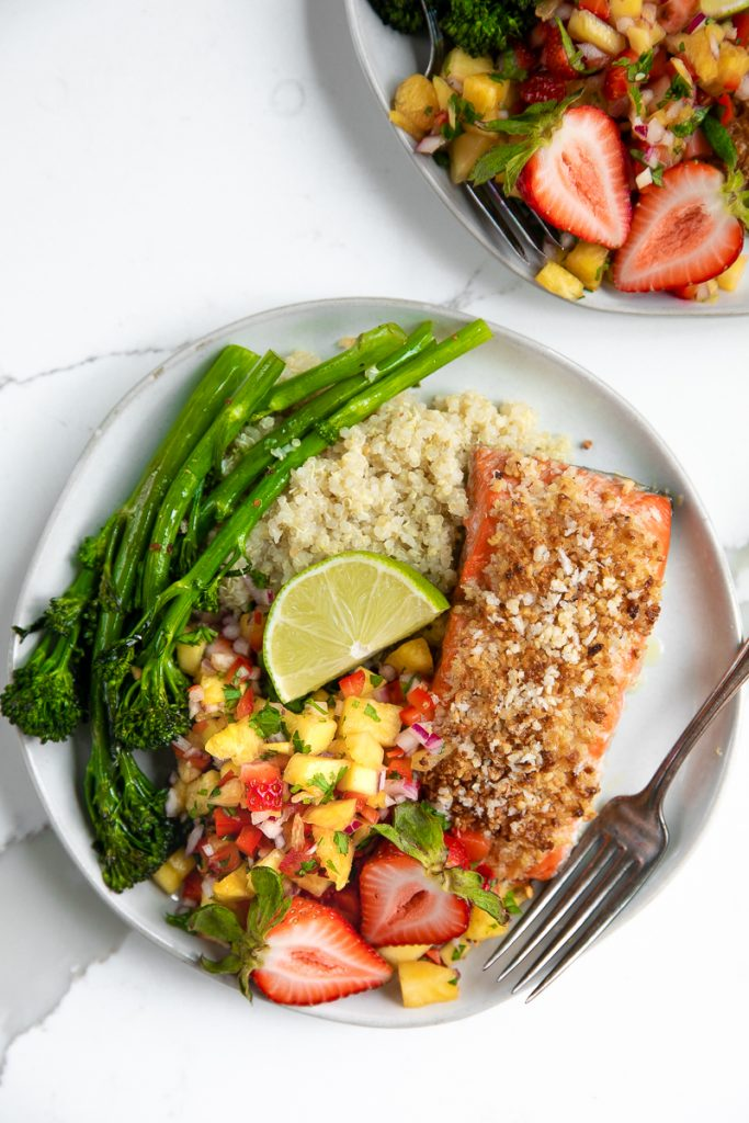 Fresh fruit salsa, quinoa, and roasted broccolini pair up with Omega-rich salmon in this crazy easy and super healthy Macadamia Crusted Salmon with Pineapple Mango Salsa.